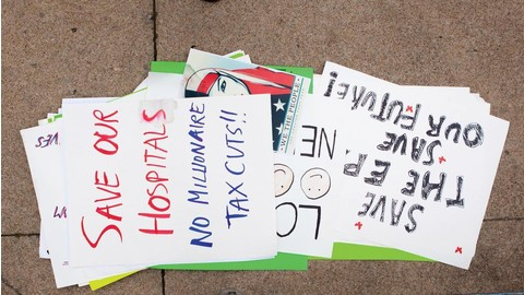 Protestors' signs piled on the Mount Vernon sidewalk